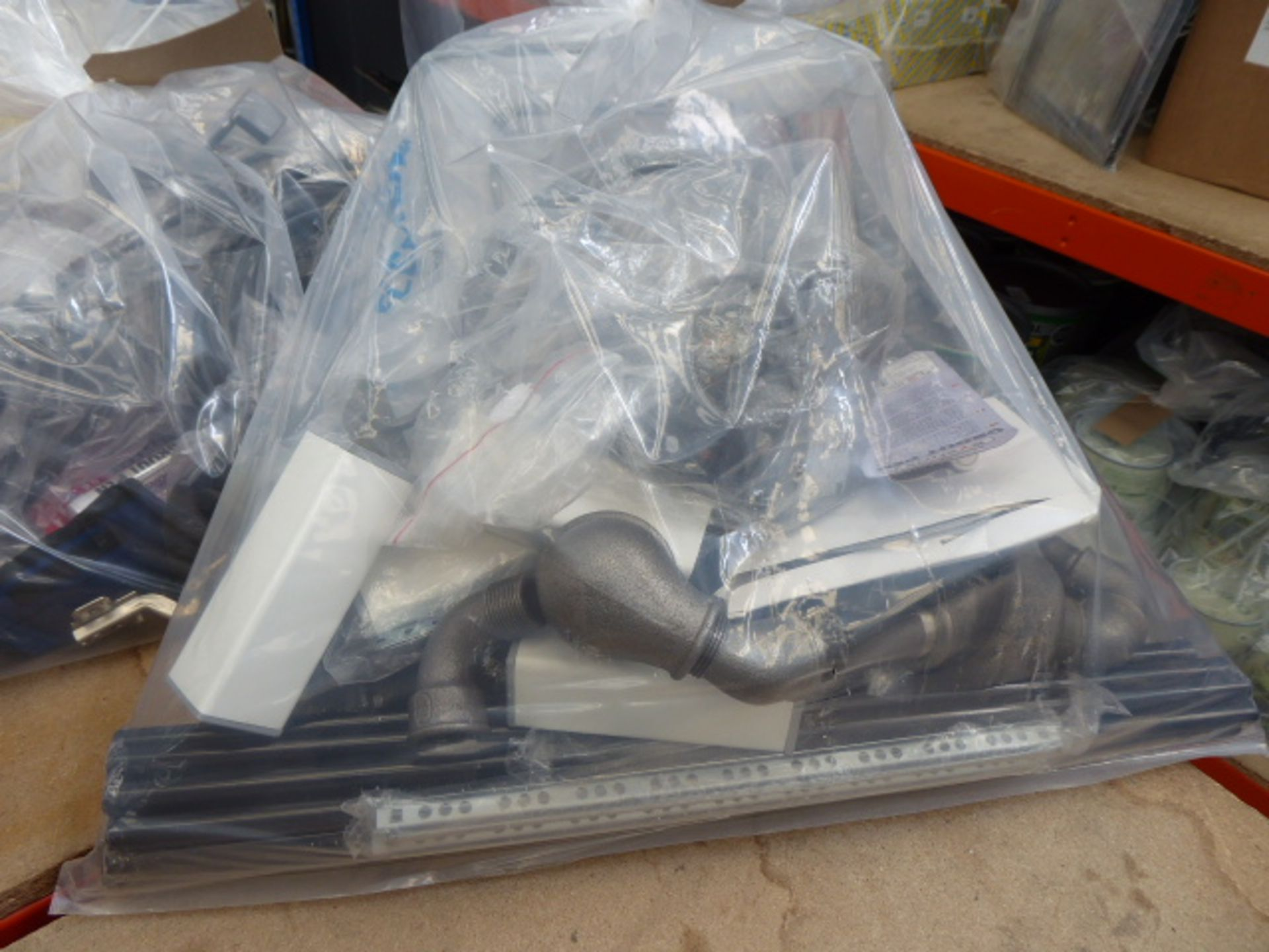 Lot 4859 - Bag containing cooker elements, Meccano parts, piping, boiler parts, furniture feet, track rod