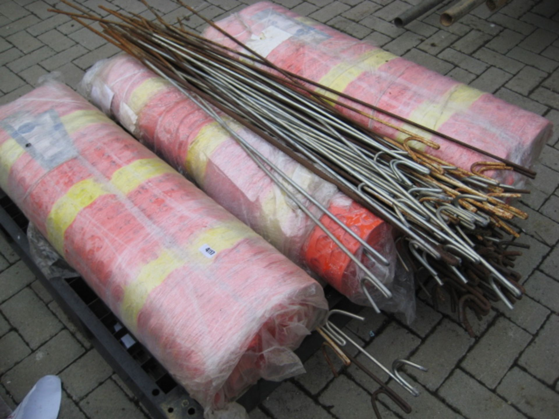 Lot 4117 - Pallet containing 3 rolls of orange and yellow safety netting and a quantity of road pins