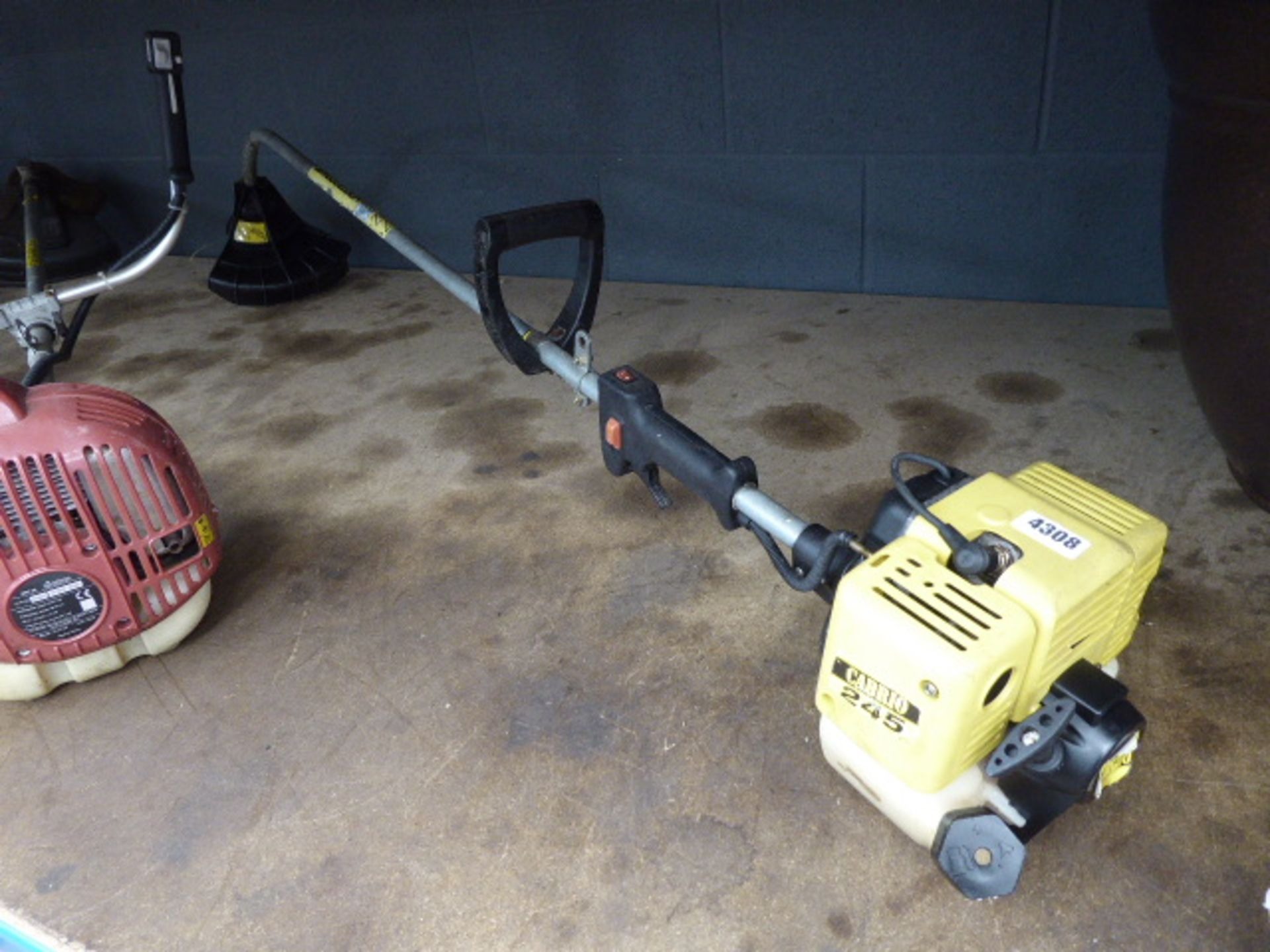 Lot 4308 - Yellow petrol powered strimmer