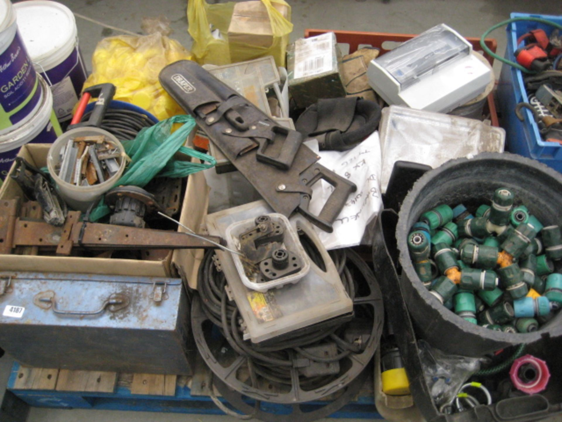 Lot 4187 - Pallet containing a quantity of work gloves, extension lead, hinges, hose lock type fittings,