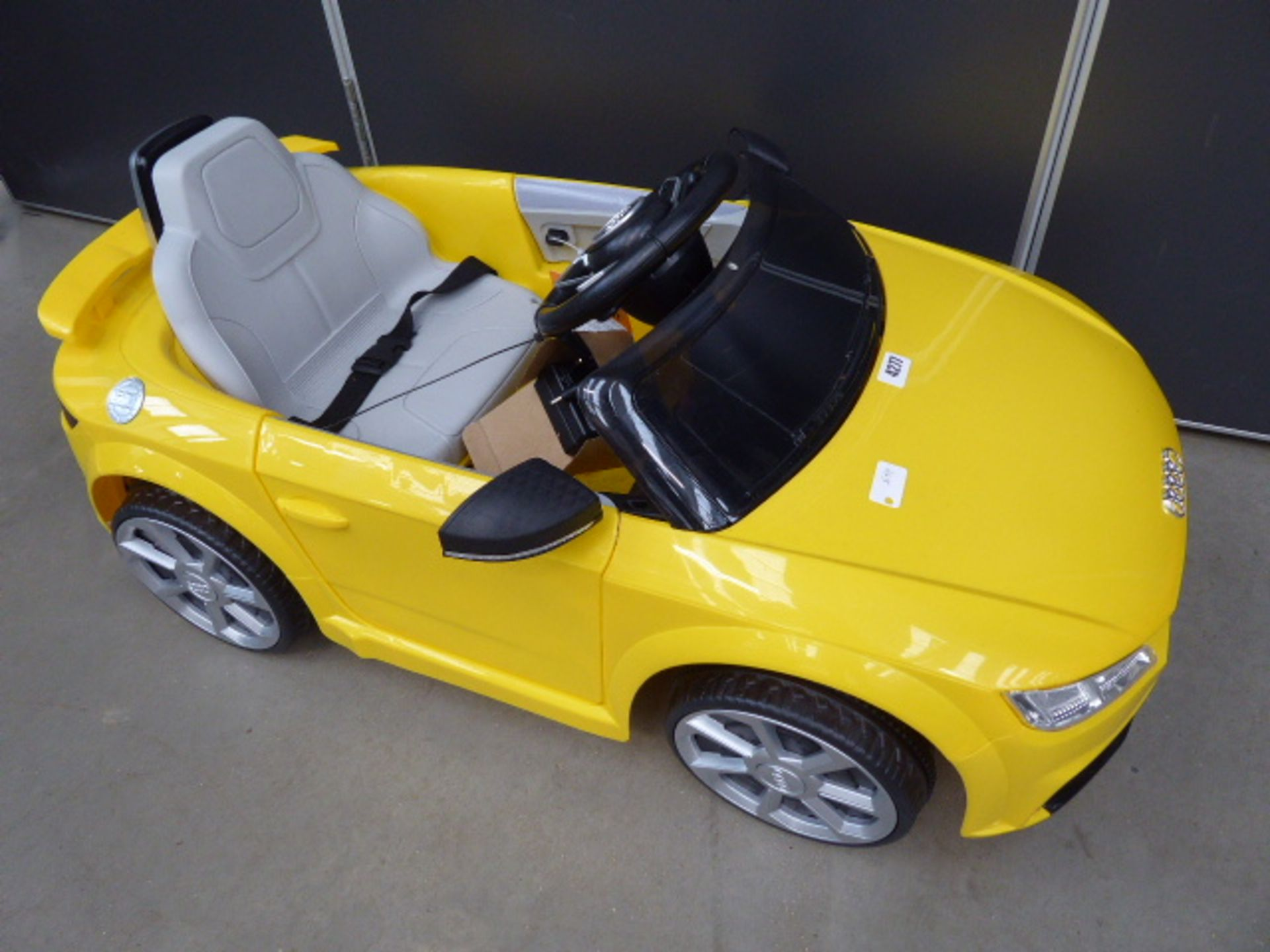 Lot 4277 - Yellow Audi TT childs electric car with charging lead