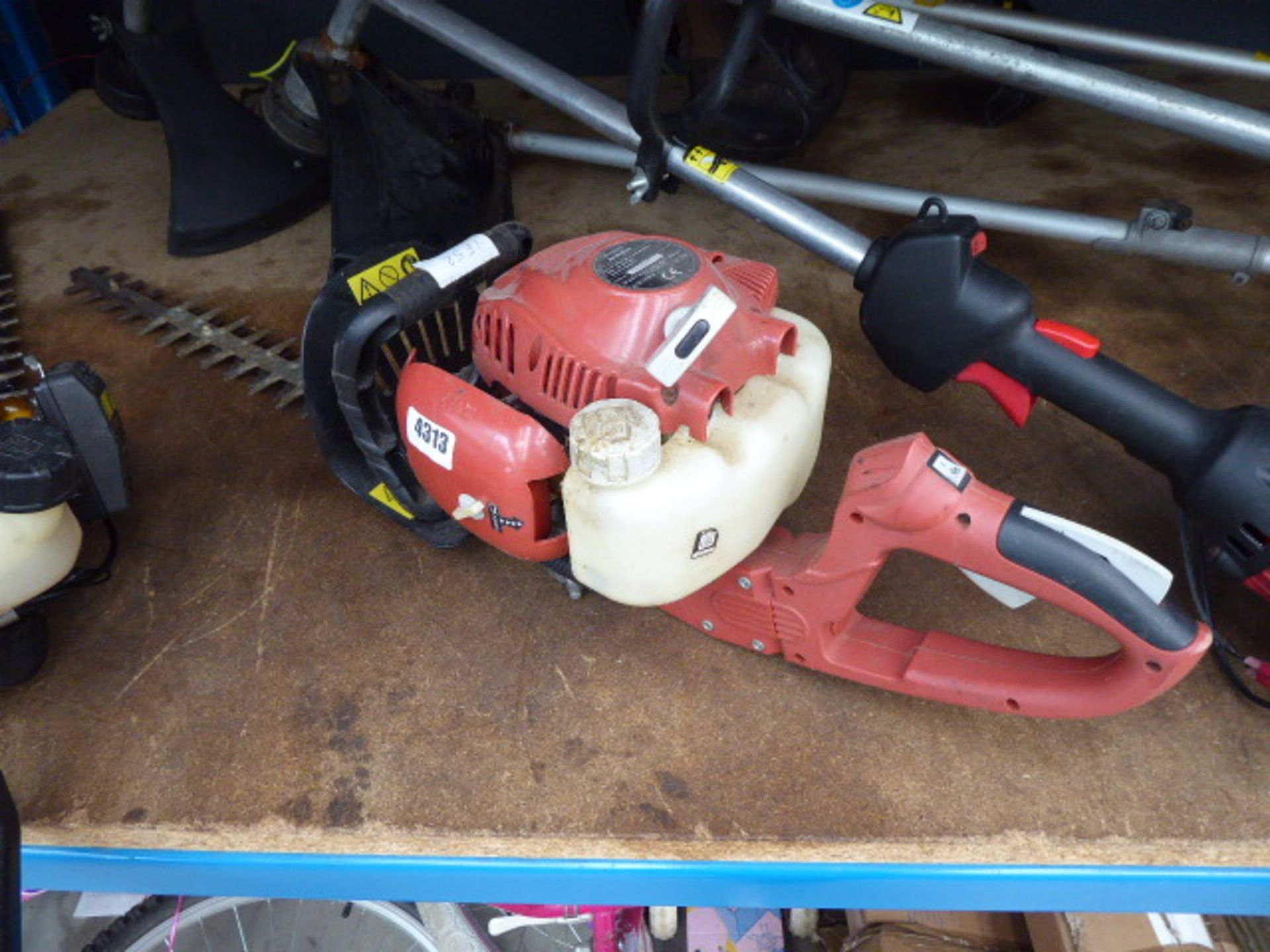 Lot 4313 - Red petrol powered hedge cutter