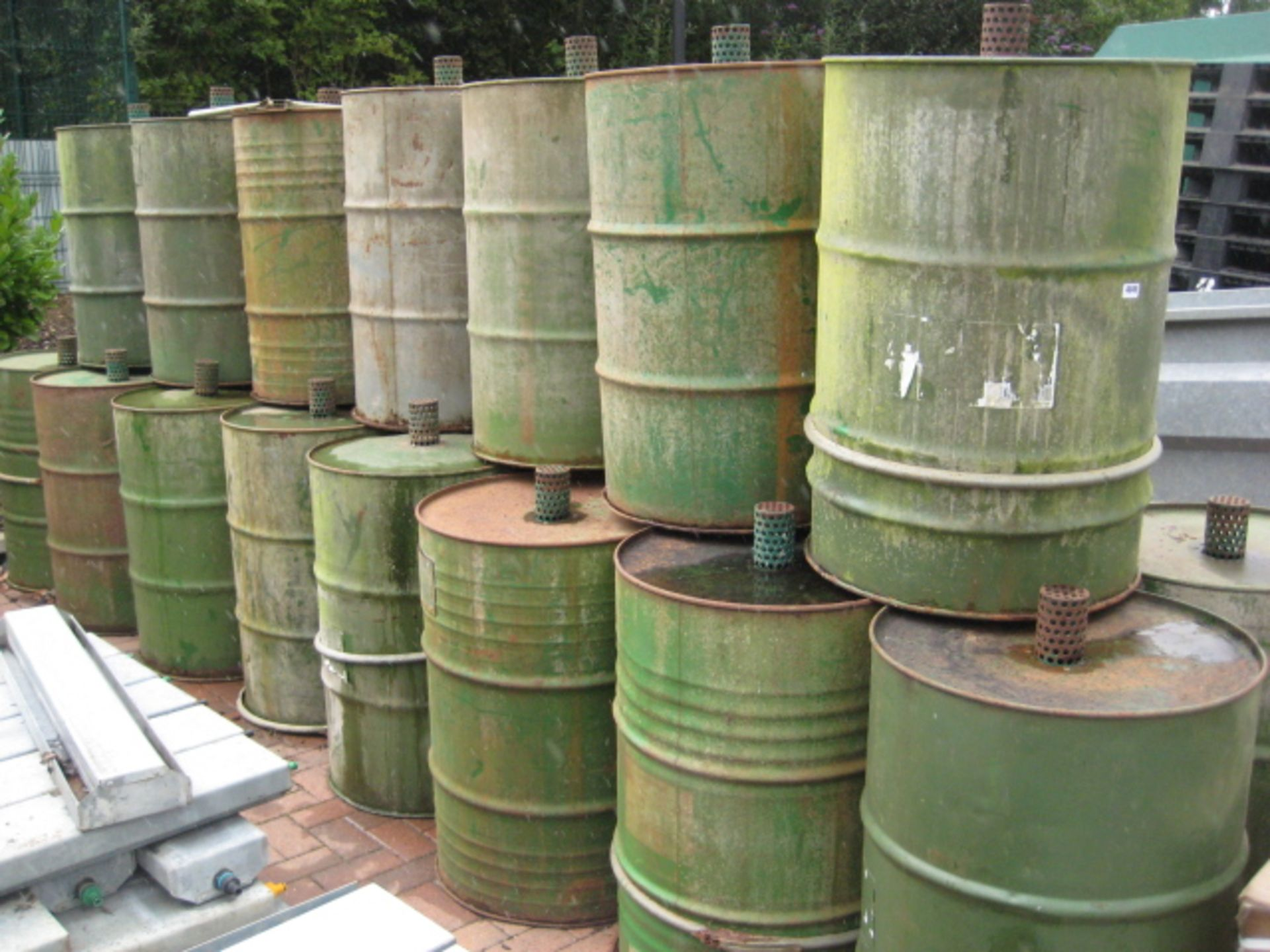 Lot 4049 - 23 x steel Pheasant feeder drums with quantity of lids