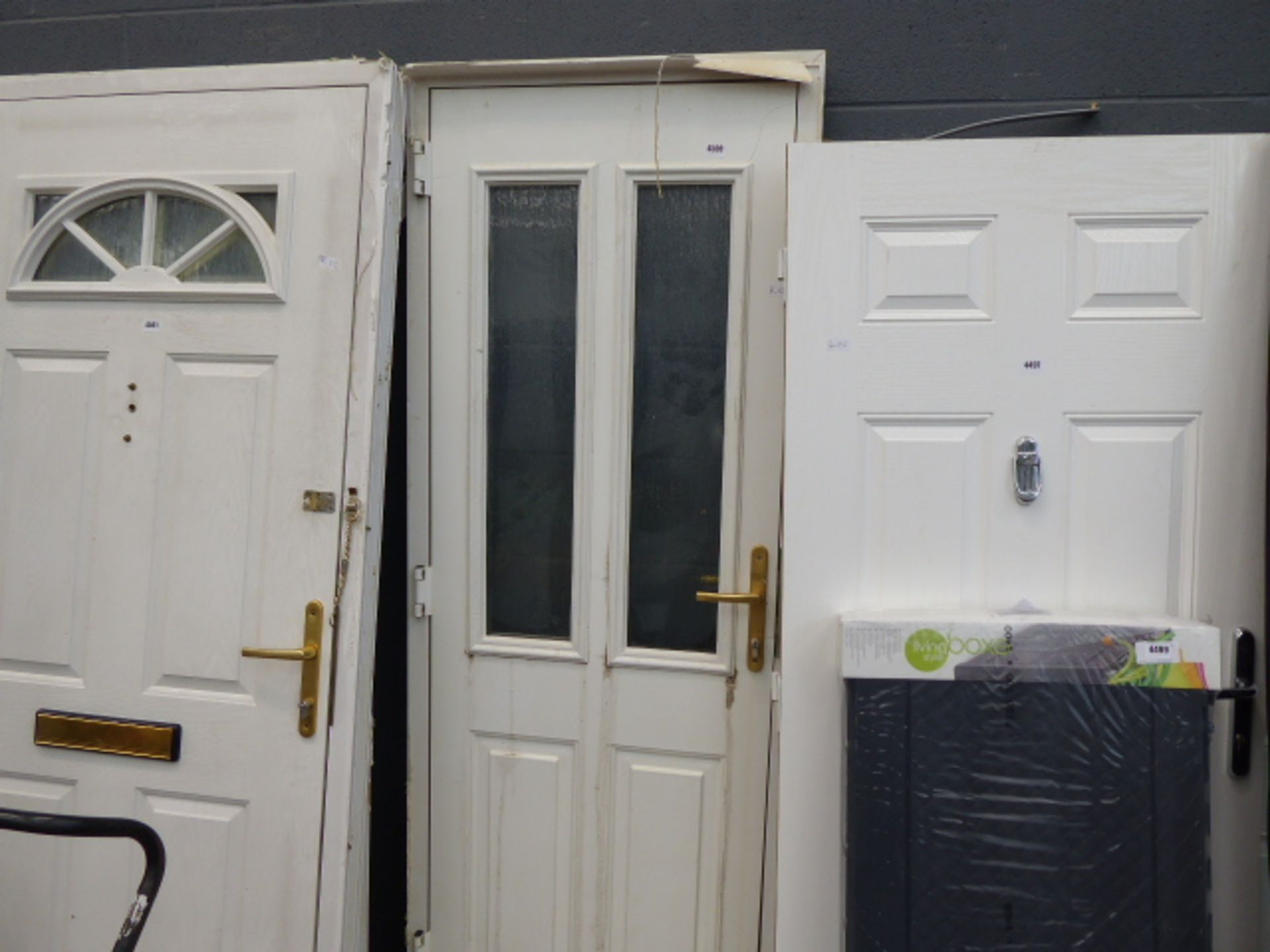 Lot 4500 - White composite front door in frame