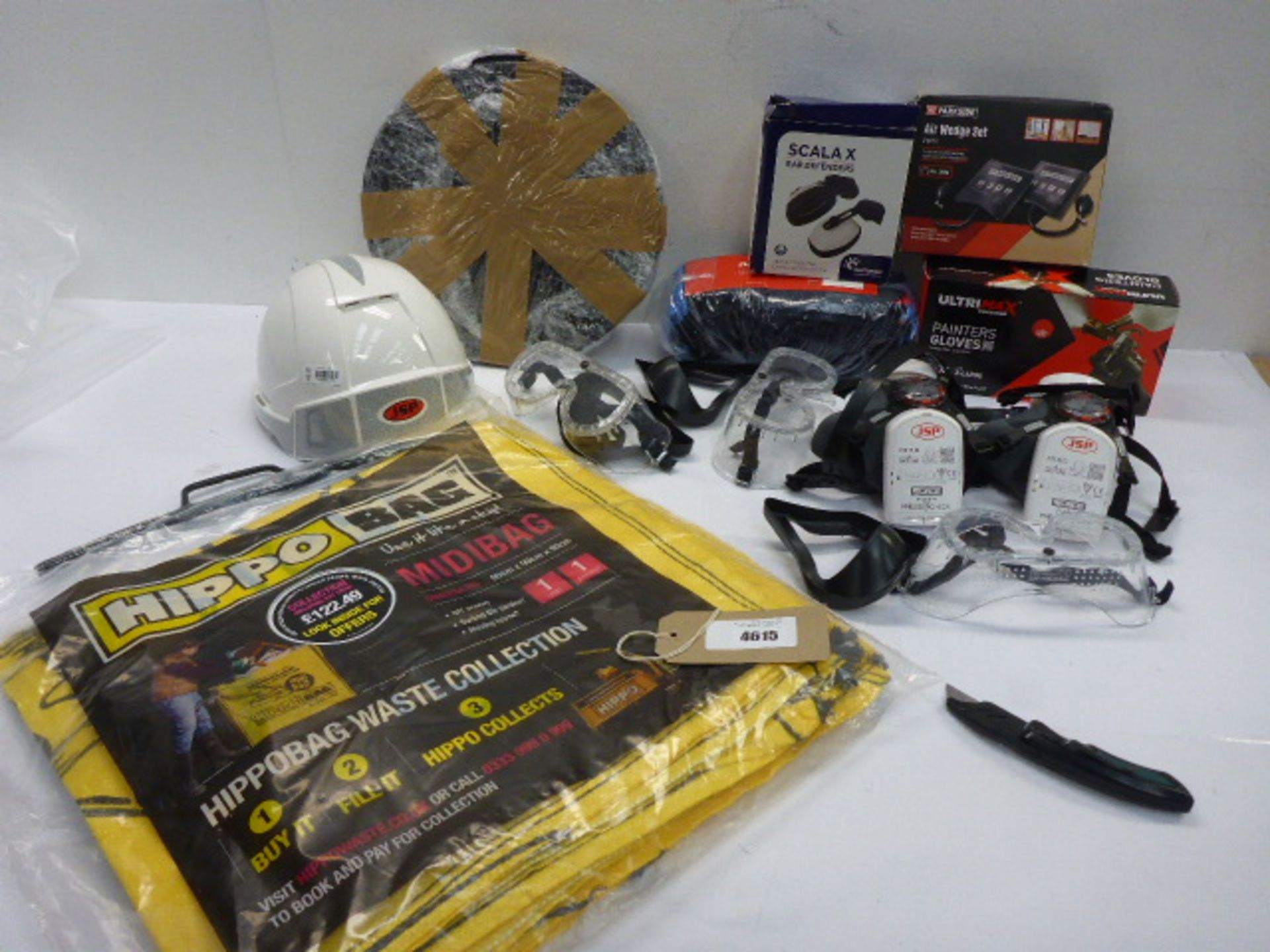 Lot 4615 - Xperteye hard hat, work gloves, Scalax ear defenders, face masks, eye goggles, roll of rubber