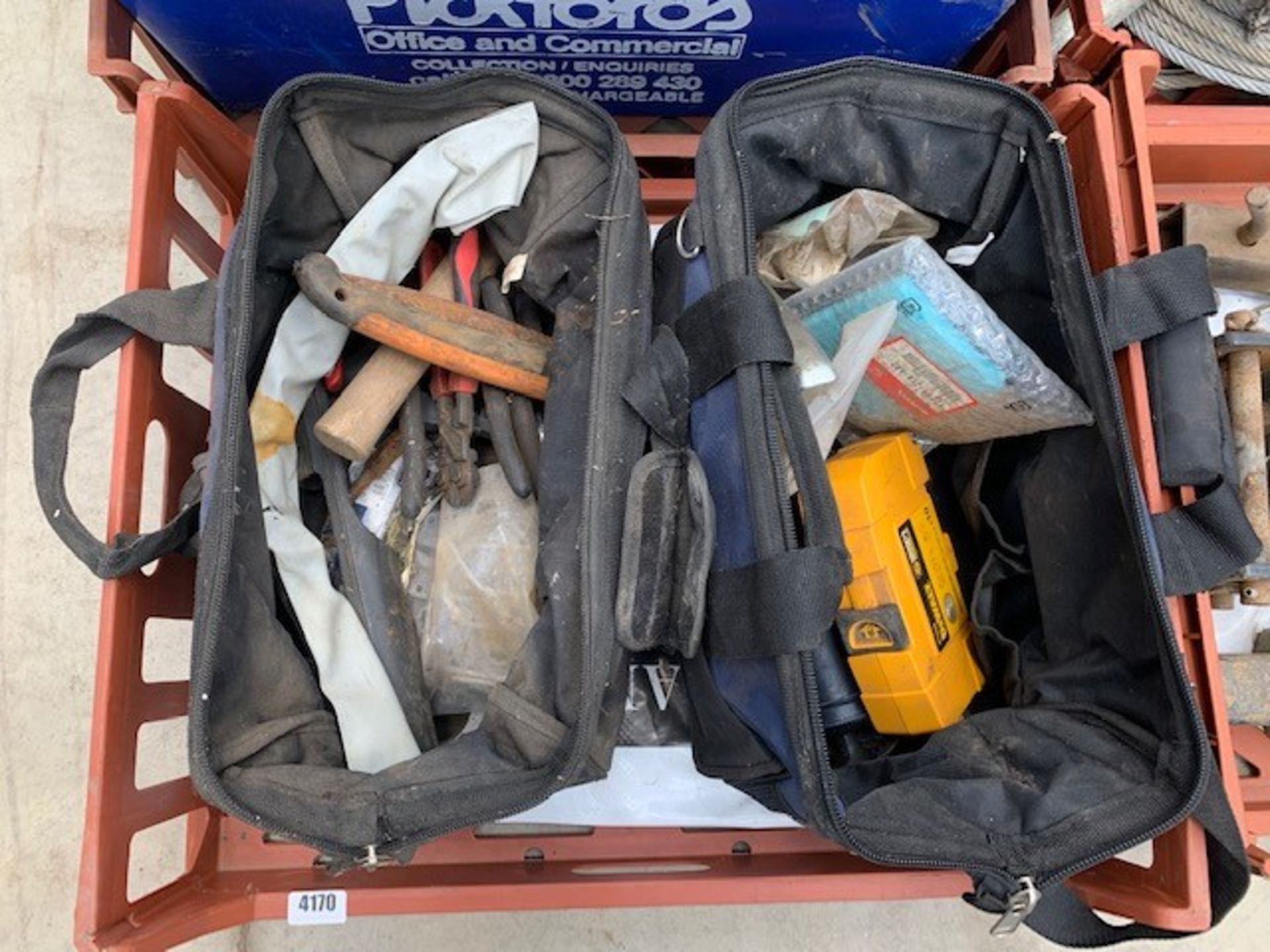 Lot 4170 - Crate containing 2 toolbags, hammer drill, brackets, etc