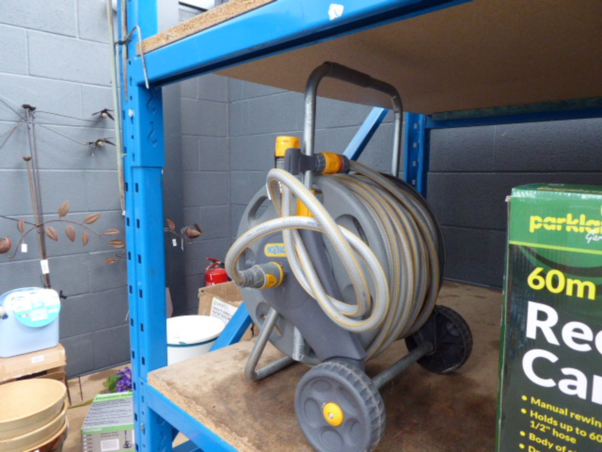 Lot 4325 - Hozelock hose reel and hose pipe