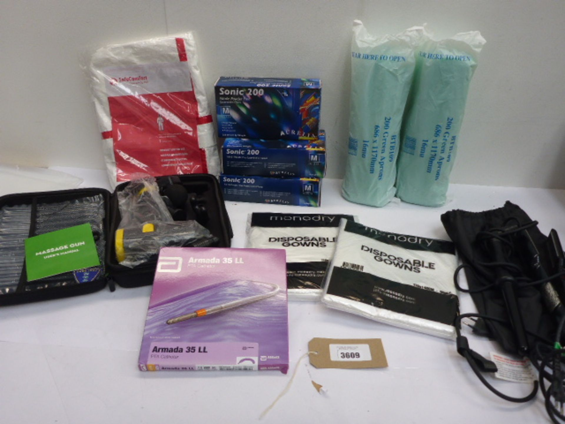 Lot 3609 - Armada 35LL catheter, 2 x 200 green aprons, 3 packs of Sonic 200 examination gloves, massage gun,