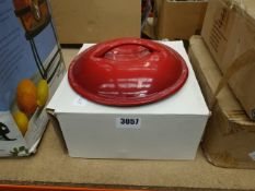 Box containing red casserole pot