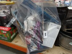 Bag containing infrared thermometers, hair straighteners, Olay makeup, water filter cartridges, etc