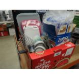 Tray containing Ziploc space bags, Surelock food containers, chopping boards, etc