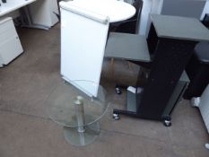 Small glass circular table with a projector mobile mobile console and an A frame white board
