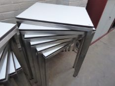Stack of 6 stainless steel and white top 60cm x 50cm rectangular stackable tables suitable for