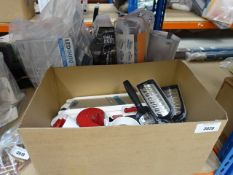 Box containing cheese graters and mixed kitchen items