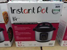 Boxed Instant Pot multi use pressure cooker