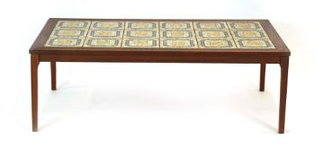 A 1970's teak coffee table, the surface inset with eighteen matching tiles,