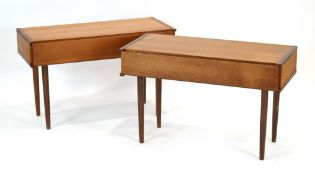 A pair of 1970's teak single-drawer side tables on tapering legs, w.