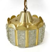 A 1970's brass coloured ceiling light with moulded glass panels around the sides