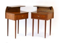 A pair of 1960's teak integral bedside cabinets with raised galleries and single drawers,