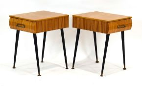 A pair of 1950/60's laminate bedside cabinets on ebonised tapering legs with brass caps, w.
