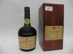 An old bottle of Courvoisier Napoloen Old Liqueur Cognac by Appointment to The Late King George VI