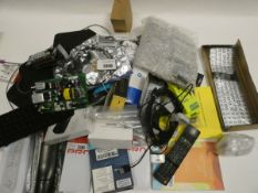 Bag containing mixed electrical related items; cables, adapters, remote controls, PSUs, spare TV