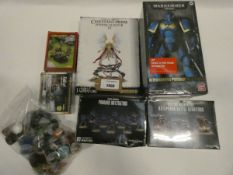 Bag contining boxed Warhammer paint pots and figures; Celestant-Prime, Ultramarines Primaris,