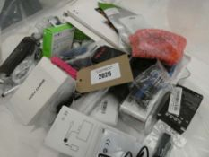 Bag containing quantity of various mobile phone accessories; cables, adapters, PSUs, earphones etc