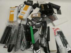 Bag containing quantity of remote controls, power supply units, speaker, Parker pen, etc