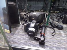 Nikon Cool Pix P100 bridge camera with carry case and monopod