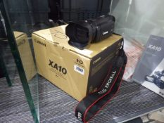 Canon XA15 HD camcorder with battery charger, 2 batteries and instruction manuals
