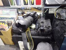 Nikon D2X digital SLR camera with Nikon ED AF-S Nikkor 28-70mm lens including battery expansion
