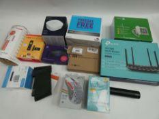 Bag containing TP-Link AC1200 router, BT 4G Assure, Fire TV stick, Doro big button home phone,
