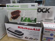 KitchenAid 3 in 1 chop and slice set and a box of vacuum pack bags