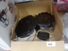 Box containing glass lidded storage jars