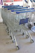 6 Wanzl wire cage 4 wheel shopping trolleys