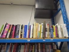 Shelf of reference and other study books.