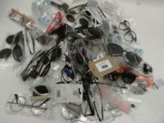 Bag containing quantity of various sunglasses and reading glasses