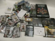 Bag containing quantity of various Warhammer sets and paint pots
