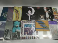 Box containing quantity of LP and 45 records to include Tame Impala, The Charlatans, Smiley & The