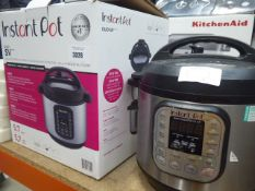 Boxed InstantPot multiuse pressure cooker plus one unboxed