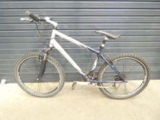 Silver and blue Trek mountain bike