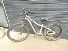 Grey and white specialised mountain bike