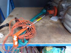 Flymo electric hedge trimmer and a Bosch electric hedge trimmer