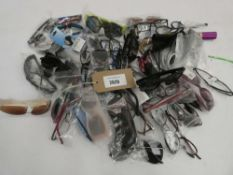 Bag containing quantity of various loose sunglasses and reading glasses