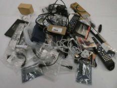 Bag containing remote controls, cabling, leads, guitar strings, drum sticks, vape kit etc