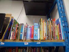 Shelf comprising of childrens books, puzzle books, etc
