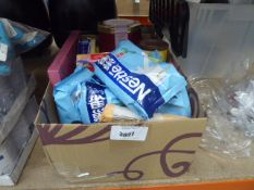 Box containing a mixture of nestle milk powder, some fruit cake, mix of assorted coffees, etc