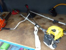 Yellow petrol powered strimmer