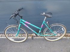 Green and pink Apollo girls mountain cycle